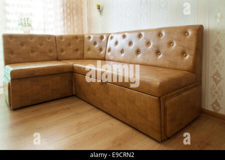 brown leather sofa in a room closeup - Stock Photo