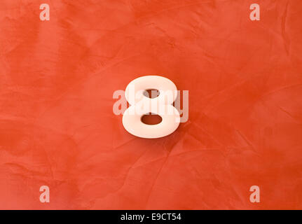Number eight 8 on red marble background - Stock Photo