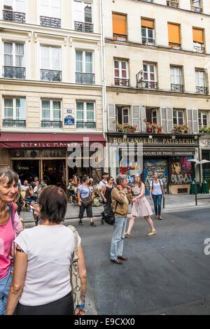 street scene at  rue sainte-croix de la bretonnerie, rue vieille du temple junction in the marais district - Stock Photo