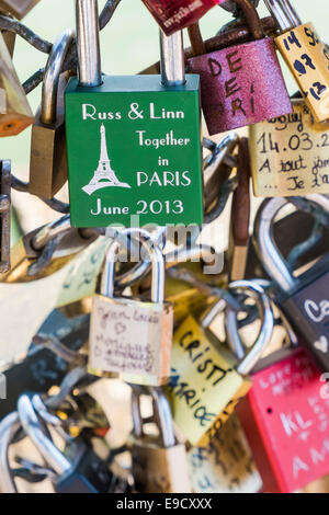 green love lock withe the engraving russ & linn, together in paris, june 2013, on the railing of pont de l´archeveche - Stock Photo