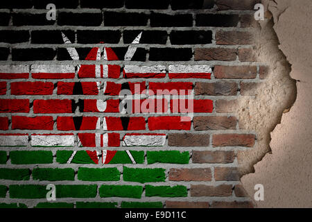 Dark brick wall texture with plaster - flag painted on wall - Kenya - Stock Photo