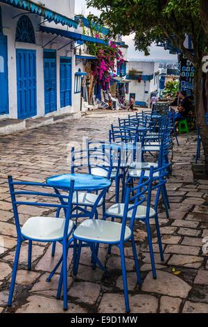 Blue chairs outside a cafe in the main street of Sidi Bou Said, Tunisia. - Stock Photo