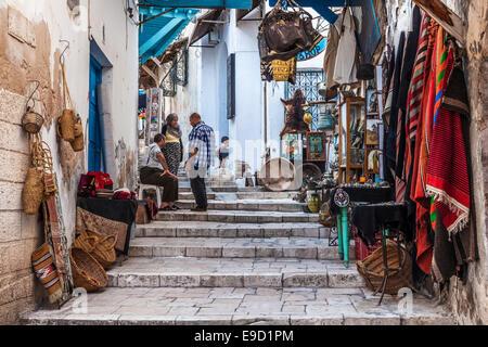 Steep, narrow street in the souk area of the Medina in Sousse,Tunisia. - Stock Photo