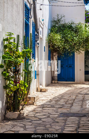 Narrow cobbled alleyway in the medina in Sousse,Tunisia. - Stock Photo