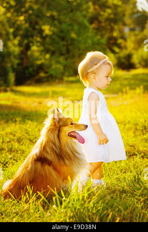Little girl and dog - Stock Photo