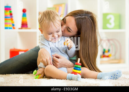 happy mother and child son playing  indoor at home - Stock Photo