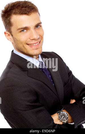 Confident young businessman on white background - Stock Photo