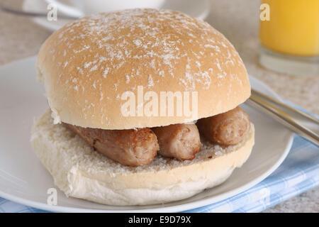 Sausage sandwich or sausage bap a favourite British snack - Stock Photo