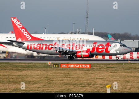 Jet2 (Manchester) Boeing 737-300 comes to a halt on runway 05L at Manchester airport. - Stock Photo
