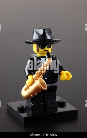 Tambov, Russian Federation - September 11, 2013 Lego Jazz Musician minifigure with saxophone on black background. - Stock Photo