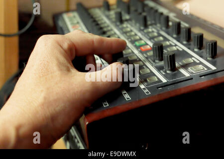 Composer hand creating a tune - Stock Photo