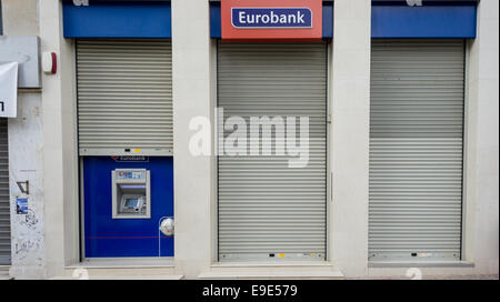 Athens, Greece. 26th October 2014. A branch (closed for Sunday) of Eurobank Ergasias, the third largest bank in - Stock Photo