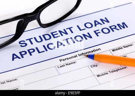 Student Loan Application form with glasses and ballpoint pen - Stock Photo