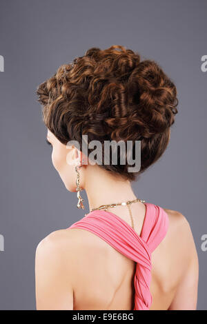 Frizzy Hair. Rear View of Brown Hair Woman with Festive Hairstyle - Stock Photo