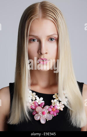 Ornamentation. Snazzy Blond Woman with Floral Necklace - Stock Photo