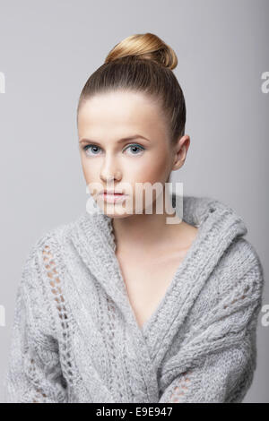 Studio Portrait of Young Female in Gray Woolen Cardigan - Stock Photo