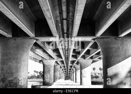 View of the underside of the  West Mission Bay Dr Bridge. Concrete columns in black and white. San Diego, California. - Stock Photo