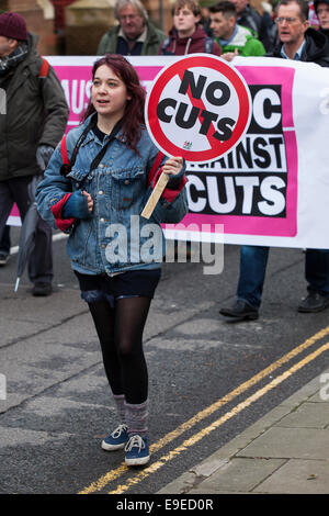 A woman holds a placard reading 'no cuts'  at an anti-austerity protest in Bristol, UK - Stock Photo