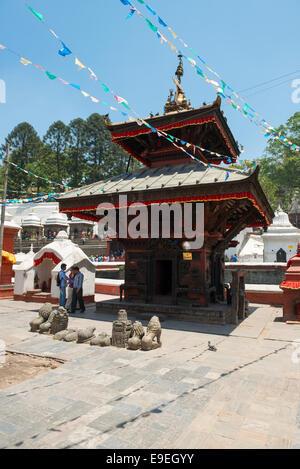 Temple on the entrance on the bridge across holy Bagmati river in Pashupatinath, Kathmandu - Stock Photo