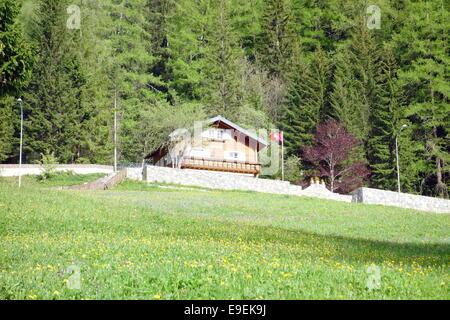 Swiss cottage in Leukerbad, Switzerland - Stock Photo