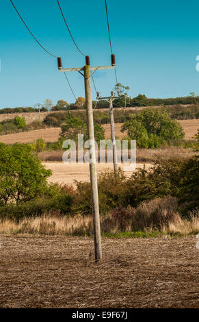 Electrical cables running across farm land in Lincolnshire, England - Stock Photo