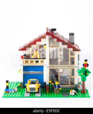Tambov, Russian Federation - January 08, 2014 LEGO Family House with yellow car and couple minifigures on white - Stock Photo