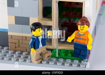 Tambov, Russian Federation - January 08, 2014 Happy LEGO couple standing near his home. Studio shot. - Stock Photo
