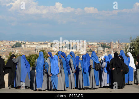 Rome. Italy. A group of nuns take in the view of the city from Piazza Garibaldi on the Gianicolo hill. - Stock Photo