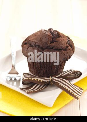 Chocolates Cupcake on a plate - Stock Photo
