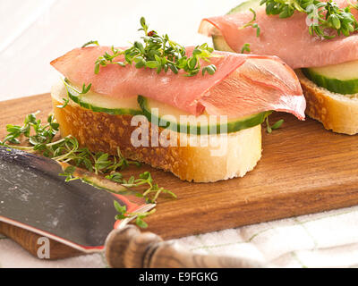 Ham sandwich with cucumber and fresh cress - Stock Photo