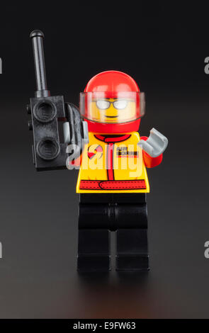 Tambov, Russian Federation - January 11, 2014 Lego pilot with walkie-talkie in his hand on black background. Studio - Stock Photo