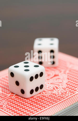 pair of dice on playing cards - Stock Photo