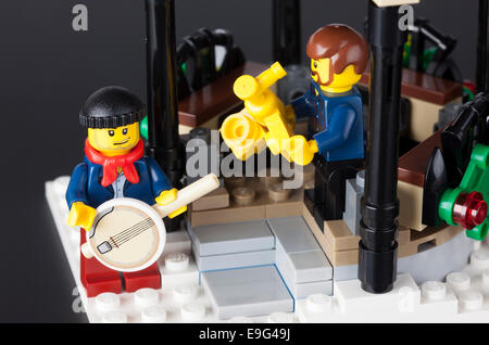 Tambov, Russian Federation - January 08, 2014 Two Lego musicians in pavilion on black background. Studio shot. - Stock Photo