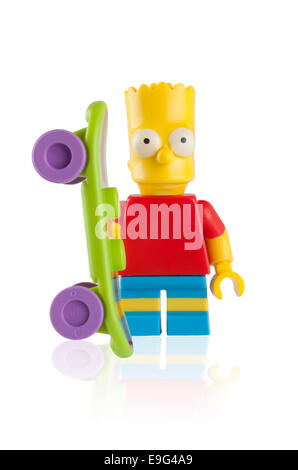 Tambov, Russian Federation - April 30, 2014 Lego Bart Simpson minifigure with skateboard on white background. Studio - Stock Photo