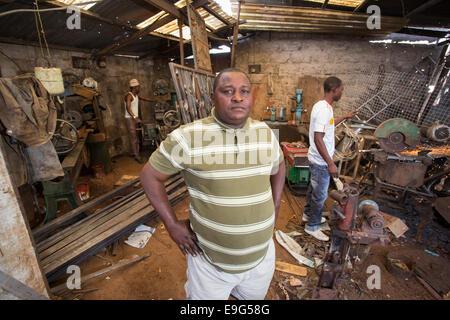 Bossman of a metal workshop in Dar es Salaam, Tanzania, East Africa. - Stock Photo