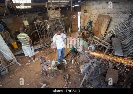 Machinery at a metal workshop in Dar es Salaam, Tanzania, East Africa. - Stock Photo
