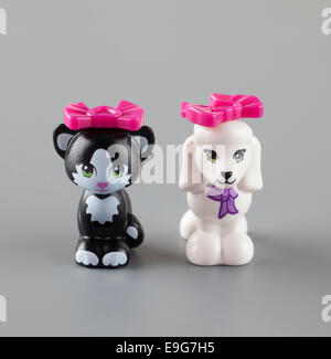 Tambov, Russian Federation - September 11, 2013 LEGO Friends Poodle and Cat minifigures with pink bows on grey background. - Stock Photo