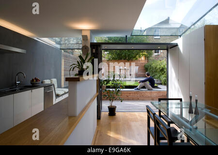 View from open plan kitchen and diner to garden in modern conversion of a Victorian terrace, Wandsworth, London, - Stock Photo