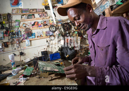 Electrical repair shop in Masama village on the foothills of Mt. Kilimanjaro, Tanzania. - Stock Photo