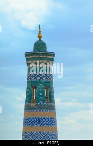 Minaret in ancient city of Khiva, Uzbekistan - Stock Photo