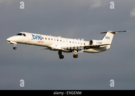 bmi Regional Embraer 145 approaches runway 23R at Manchester airport. - Stock Photo