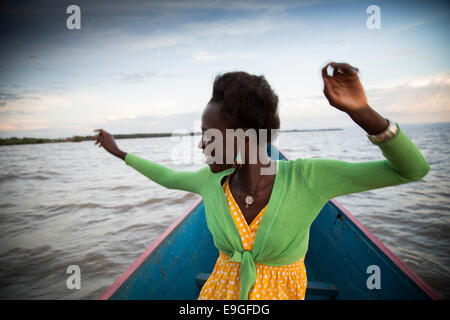 A modern young African woman having fun on Lake Victoria, near Kisumu, Kenya - Stock Photo