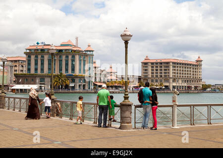 Local people at the Caudan Waterfront, a modern development in Port Louis, Mauritius - Stock Photo