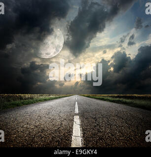 Highway and the moon. Elements of this image furnished by NASA - Stock Photo