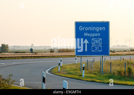 Ramp of the Autobahn in Northern Germany towards Groningen, near the border with the Netherlands - Stock Photo