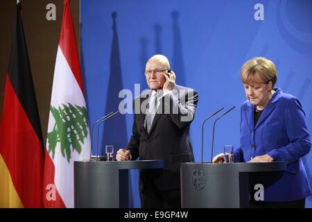 Berlin, Germany. 27th Oct, 2014. German Chancellor Merkel and Lebanese President Tammam Selam talk to the media - Stock Photo