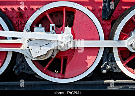 Closeup view of steam locomotive wheels, drives, rods, links and other mechanical details. Braking system - Stock Photo