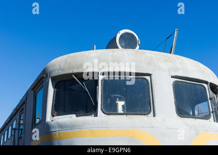 Closeup frontal view of an old diesel locomotive against the background of the clear blue sky - Stock Photo
