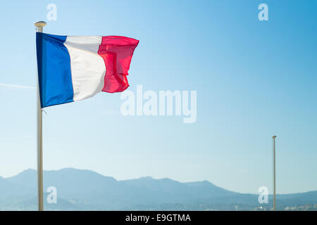 French flag flown on the beach in Cannes - Stock Photo