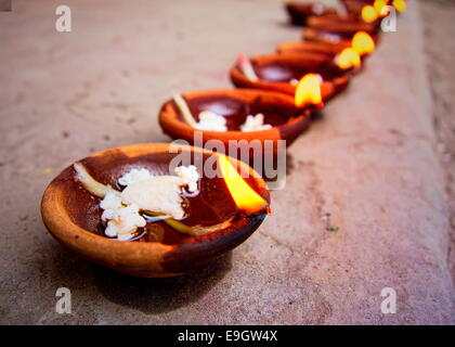 Burning oil lamps for Diwali - Stock Photo